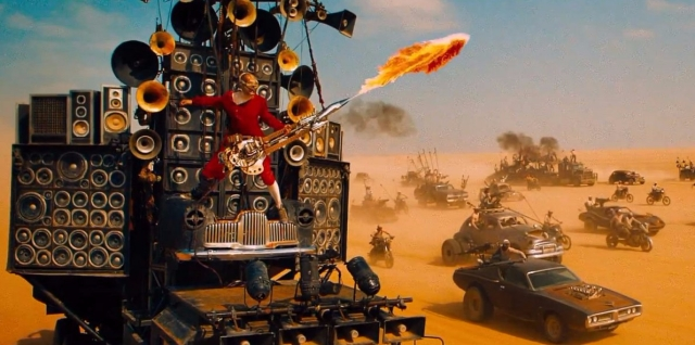 the-man-behind-the-awesome-flamethrower-guitar-player-in-mad-max-fury-road-is-a-popular-australian-musician (1)