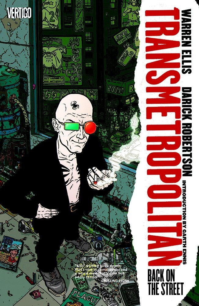 Cover of Transmetropolitan's first trade paperback. Spider Jerusalem, a bald man in a black blazer with no shirt wears mismatched sunglasses and holds a smoking cigarette while standing on a decrepit city sidewalk.