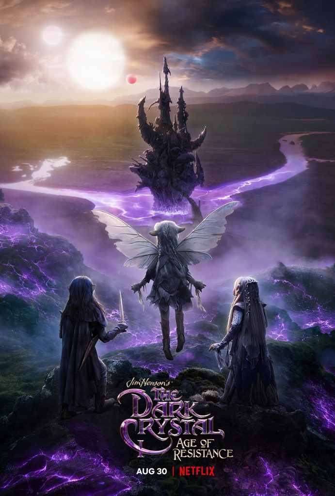 Poster for The Dark Crystal: Age of Resistance, shows the backs of the three main characters as they look upon the castle of the Skeksis.